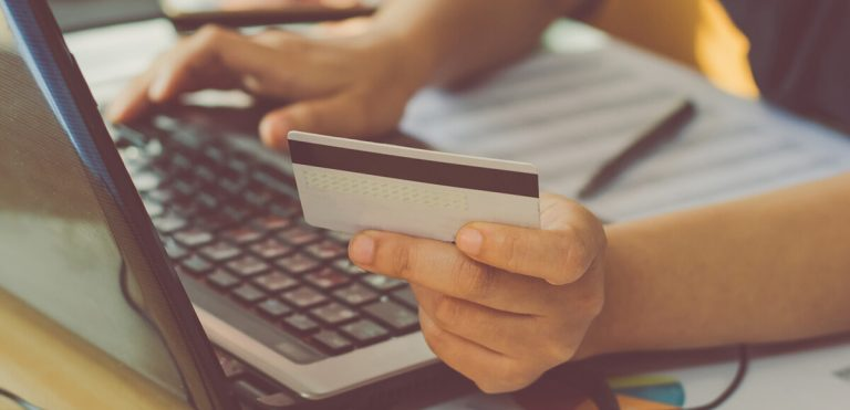 person holding credit card and ordering from an online store